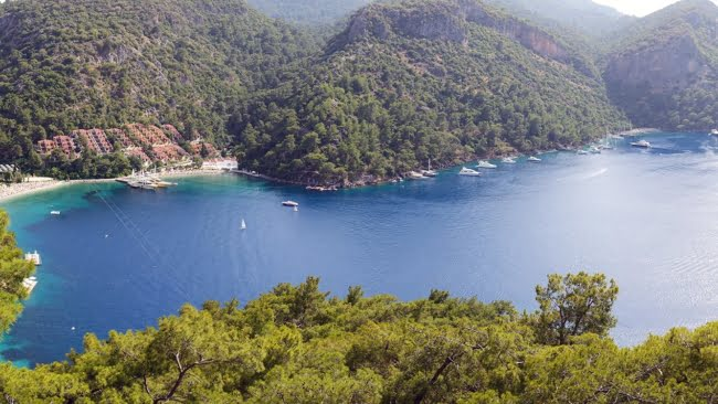 Panorama of yachts at the pier and beach Fethiye